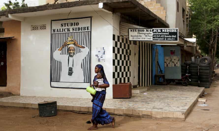 Woman walks past Malick Sidibé's studio
