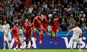 Spain's Isco shoots at goal from a free kick.