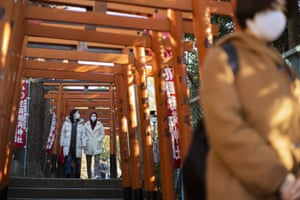 Worshippers visit shrines situated side by side in Tokyo on New Year's Day, Friday, 1 January, 2021.