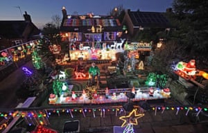 Eric Marshall in front of his Christmas lights display at his home in Bagby, North Yorkshire