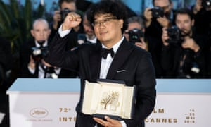 Defiant ... director Bong Joon-ho poses with the Palme d'Or award at the Cannes film festival in 2019.