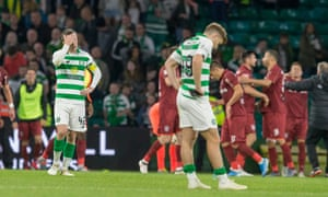 Celtic's Callum McGregor and James Forrest show their dejection after Cluj knocked the Scottish champions out of the Champions League qualifying stages.