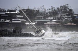 A boat smashed against rocks at Airlie Beach
