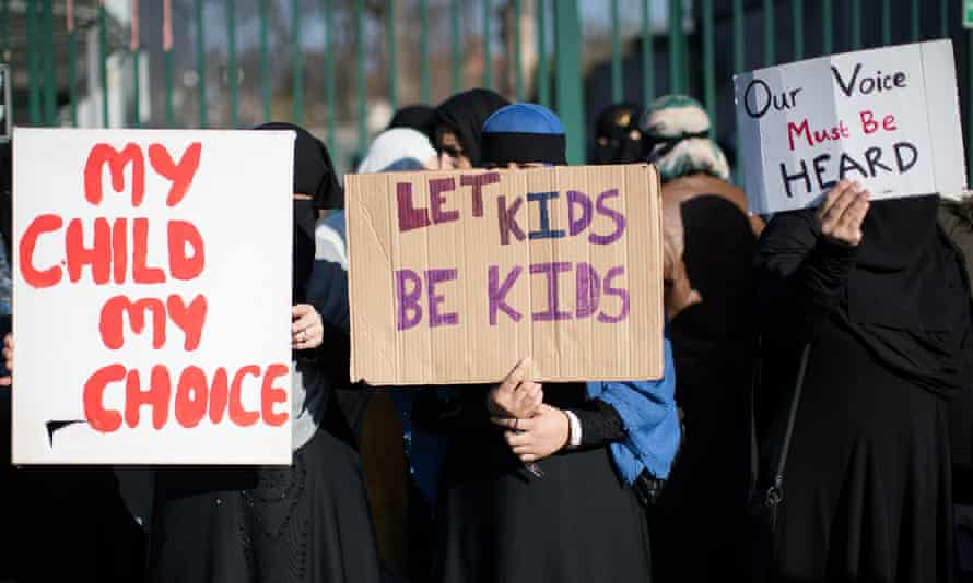 Parents and children demonstrate against lessons about gay relationships.