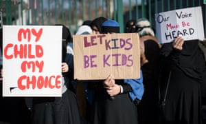 Protesters outside Anderton Park primary school demonstrate against the lessons about gay relationships.