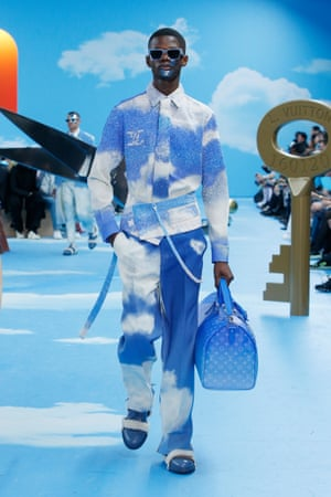 Louis VuittonMore blue-sky thinking came from Virgil Abloh, who looked at the suit through the prism of adolescence, and the idea of the suit as sartorial bridge from childhood to adulthood. Abloh turned that idea on its head by playing with surreal codes such as Magritte's clouds to decorate his tailoring. The more traditional suits which opened the show were styled with trunk and steamer bags that had been bent to give a curved shape. The Dali-like set featured the tools of artisans, sized to Alice-in-Wonderland proportions.