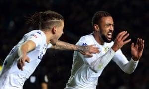 Kemar Roofe celebrates scoring Leeds' third and winning goal against Blackburn, alongside Kalvin Phillips