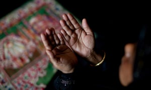 Jume, a refugee from Myanmar living in the United States, prays during the holy period of Ramadan.