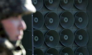 a South Korean soldier stands near the loudspeakers near the border area between South Korea and North Korea