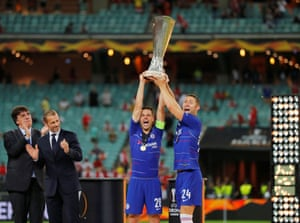 Chelsea's Gary Cahill and Cesar Azpilicueta celebrate winning the Europa League with the trophy as UEFA president Aleksander Ceferin looks on.