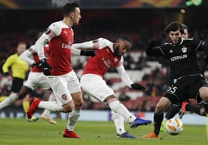 Arsenal's Alexandre Lacazette shoots to score his side's first goal