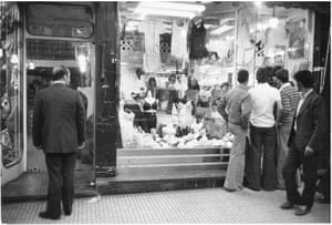 Men looking in the window of an underwear shop, Tehran