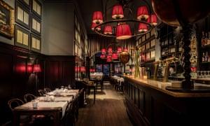 Dimly-lit interior of Café Restaurant Van Puffelen in Amsterdam, the Netherlands.