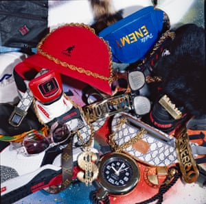hip hop ephemera shot by Normski in 1994 on the floor of his home. The accessories loaned by Camden's 4 Star General in London, included snakeskin Cazal glasses, Task Force trainers and a Flavor Flav clock.