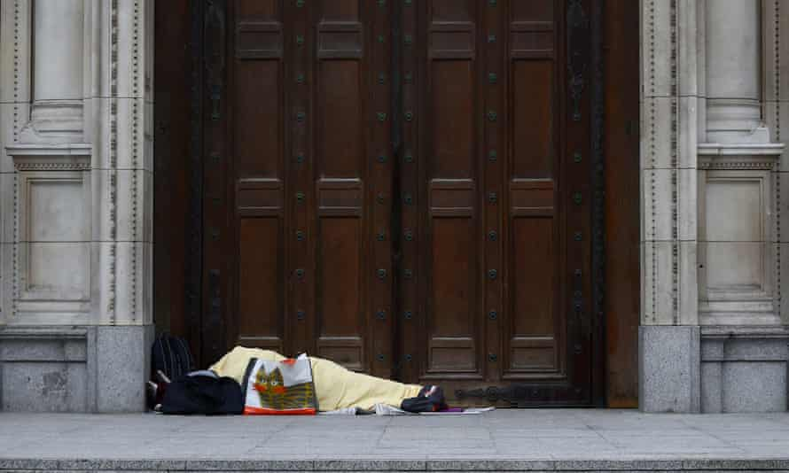 A homeless person sleeps in a doorway at Westminster Cathedral during the first wave of the pandemic