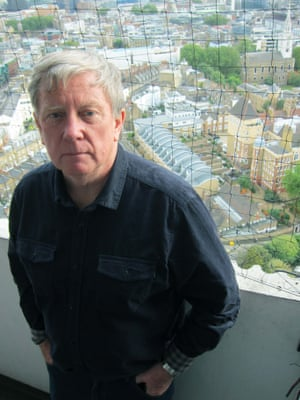 Colin O'Brien on the balcony of the flat in Clerkenwell, which he moved into with his parents when it was built in 1966.