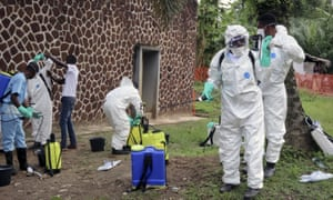 Congolese health officials prepare to disinfect people and buildings at the general referral hospital in Mbandaka, DRC