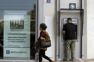 A man uses an ATM outside a bank in Athens, Friday, June 19, 2015. Several European countries said openly they are getting ready for the possibility of Greece leaving the euro. And though there was no sign of panic in the streets of Greece over that prospect, officials say Greeks are taking money out of banks in growing amounts. (AP Photo/Thanassis Stavrakis)