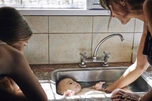 Jules in the Sink by Sophie Ebrard, 2014 © Sophie Ebrard From the series Finca la Prospera, March 2014