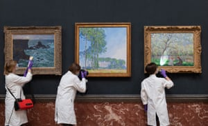 Cambridge, England. Conservators dust, photograph and inspect Rocks at Port Coton, the Lion Rock; Poplars and Springtime by Claude Monet at the Fitzwilliam museum as they make final preparations to reopen following the easing of lockdown restrictions in England