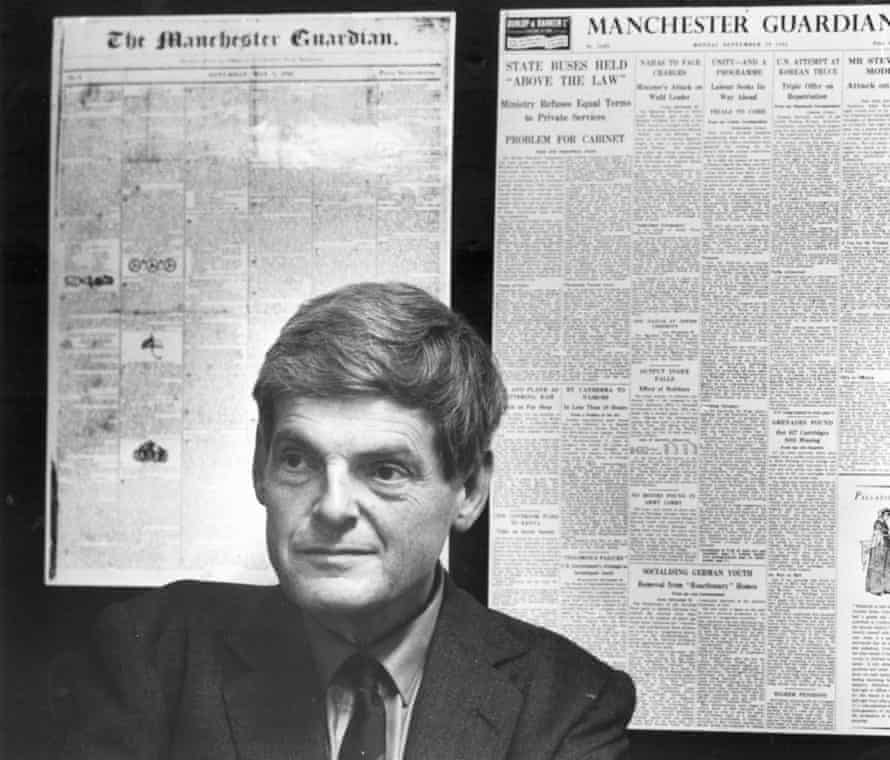 Peter Preston in front of early editions of the Manchester Guardian