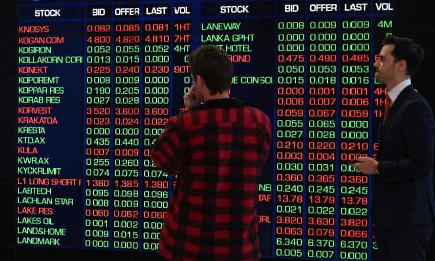 Staff monitor stocks prices on an electronic screen at the Australian Stock Exchange in Sydney.