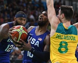 Team USA' s Kyrie Irving drives past Australia's Matthew Dellavedova in the men's basketball.