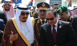 The Egyptian president Abdel Fatah al-Sisi (r) talks to Saudi Arabia's King Salman on the sidelines of the Arab League summit in Sharm el-Sheikh