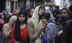 Relatives mourn Mohammad Mudasir, 31, who was killed in rioting in Delhi.