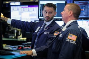 Traders work on the floor at the NYSE in New YorkTraders work on the floor at the New York Stock Exchange (NYSE) in New York, U.S., July 1, 2019. REUTERS/Brendan McDermid