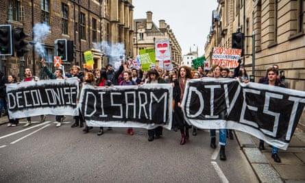 Cambridge University students march in Cambridge.