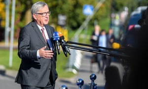 Jean-Claude Juncker talks to journalists as he arrives for a summit in Tallinn, Estonia, on Friday.