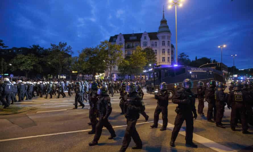 Riot police officers attend an anti-G20 protest in Schanzenviertel before the summit in Hamburg