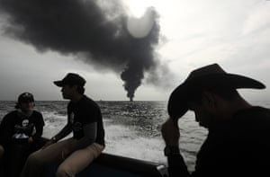 Members of marine wildlife conservation organisation Sea Shepherd monitor the fuel tanker Burgos as it continues to burn a day after it erupted in flames off the coast of the port city of Boca del Rio