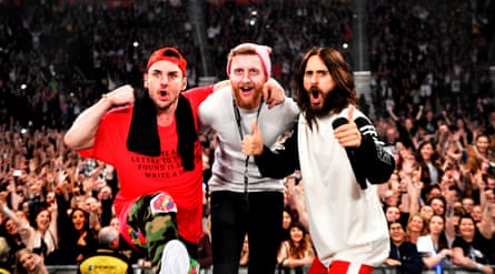 Shannon Leto (left) and Jared Leto pose with a fan.