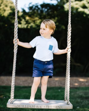 Prince George playing on a swing.