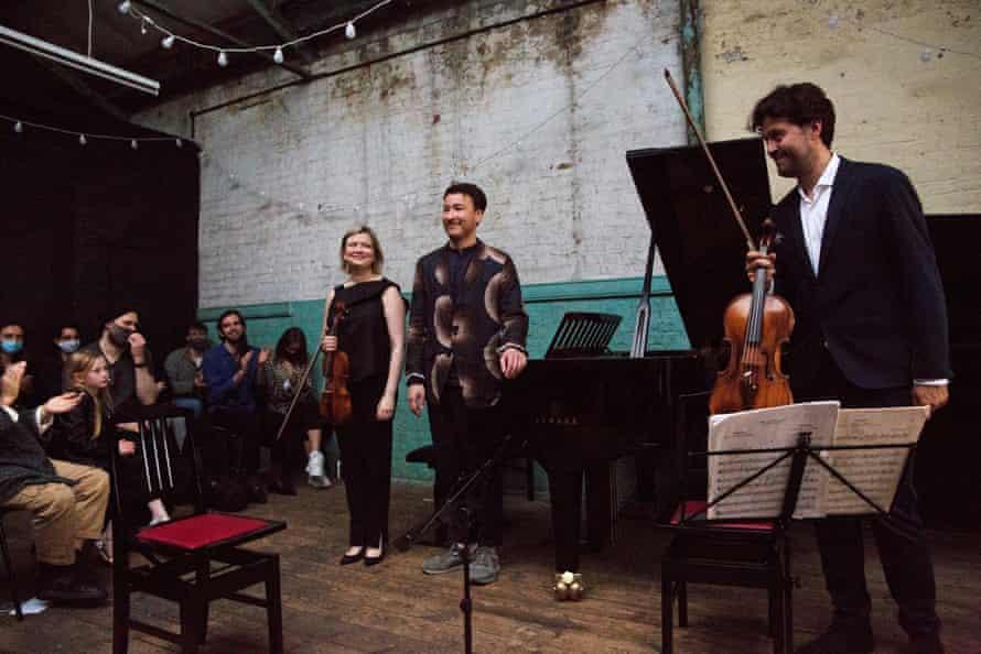 Alina Ibragimova, Samson Tsoy and Lawrence Power take a bow at the Ragged music festival.