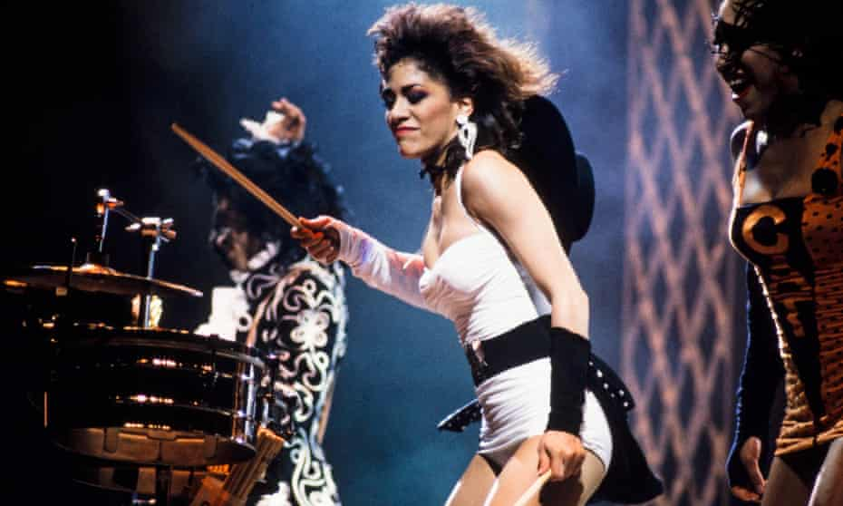 Sheila E performing with Prince (left) and Cat (right) in London in 1988
