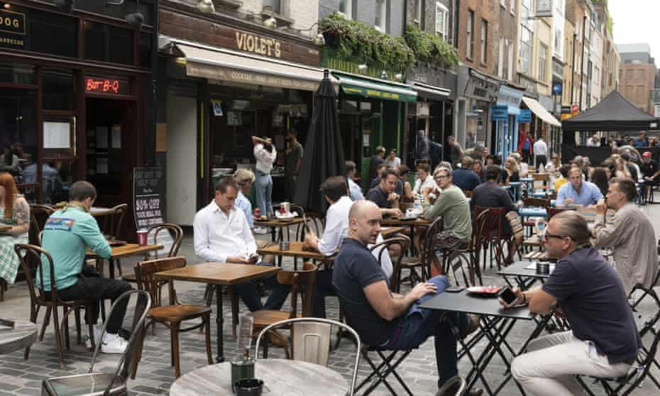 Diners in London's Soho taking advantage of 'Eat Out to Help Out'.