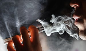 a man smokes an E-Cigarette