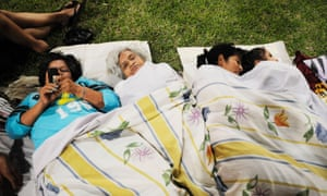 People resting in a park after an earthquake in the city of Guayaquil
