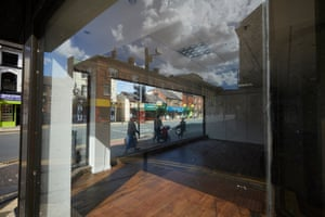 A shopping street seen through the window of the recently closed Beales department store, previously known as Whitakers.