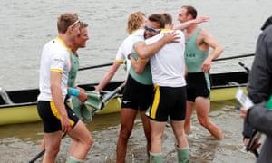 Cambridge celebrate winning the men's boat race.