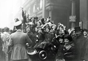 Crowds in London celebrate the armistice at the end of the first world war.