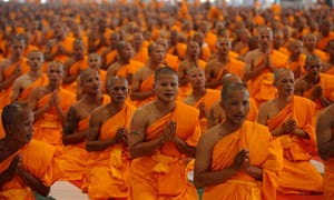 Thai buddhist monks praying