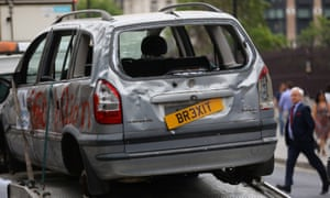 Pro-EU campaign group Open Britain drives a broken car around Parliament Square as the government releases its Brexit white paper.