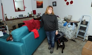 Barbara Campion and her dog, Roxy, in living room