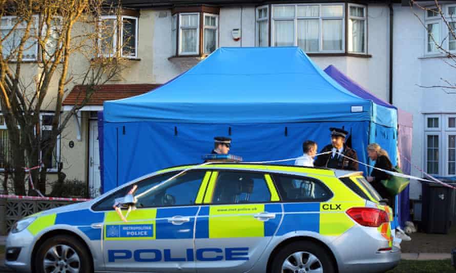 Police outside the home of Nikolai Glushkov in New Malden, south west London.