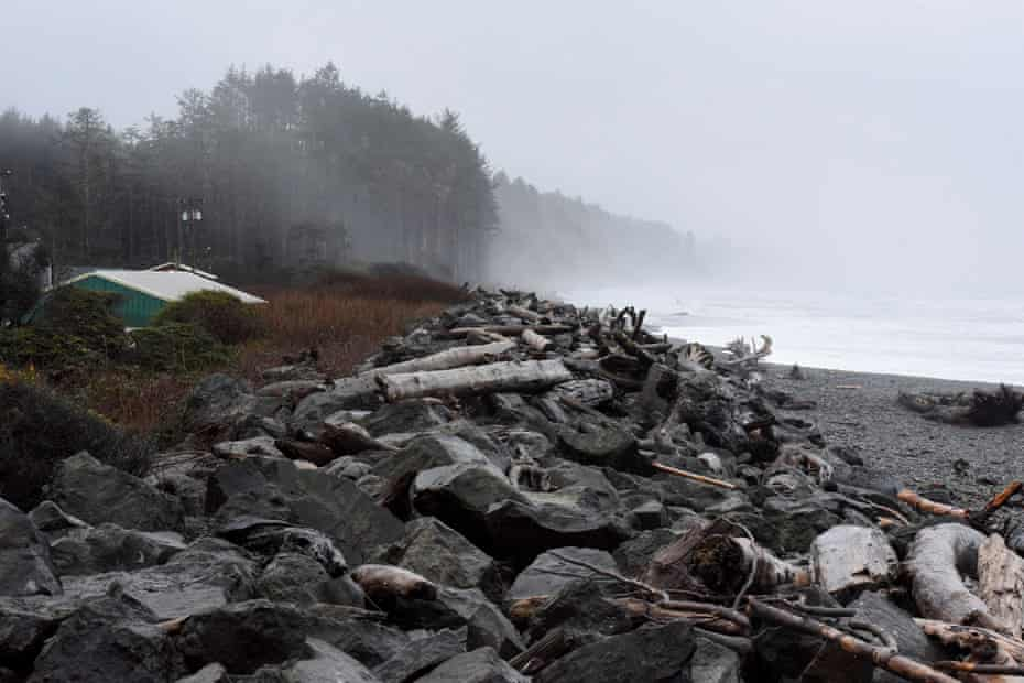 A sea wall, damaged by storm surges and high tides, stands along the coastline near Quinault Indian Nation's main village.
