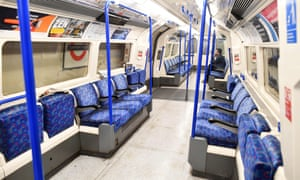 A nearly empty tube carriage during rush hour in London.
